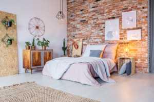 bright bedroom with brick wall PZER57Y 300x200 -
